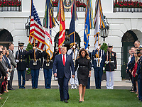 United States President Donald J. Trump and first lady Melania Trump walk down the South Lawn of the White House to observe a moment of silence at 8:46am EDT in commemoration of  the 18th anniversary of the terrorist attacks on the World Trade Center in New York, NY and the Pentagon in Washington, DC on Wednesday, September 11, 2019.<br /> Credit: Ron Sachs / CNP /MediaPunch