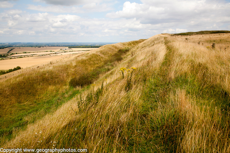 Ditch and earthwork ramparts of prehistoric hill fort of Liddington Castle, Wiltshire, England, UK