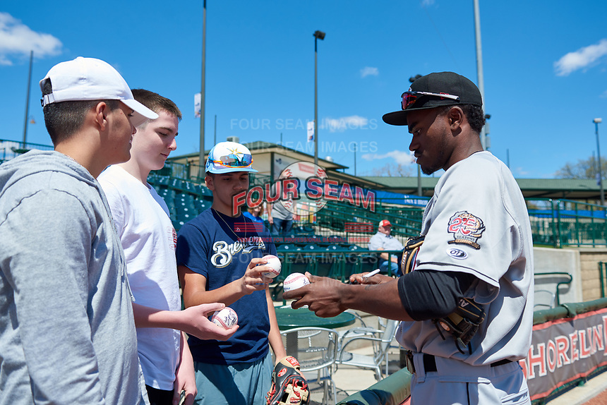 Wisconsin Timber Rattlers Korry Howell (36) signs autographs before a Midwest League game against the Great Lakes Loons at Dow Diamond on May 4, 2019 in Midland, Michigan. Great Lakes defeated Wisconsin 5-1. (Zachary Lucy/Four Seam Images)