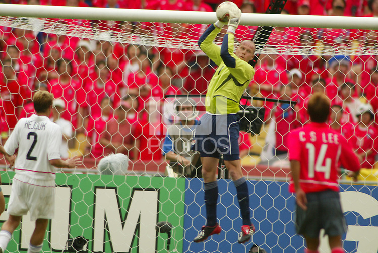Brad Friedel makes a stop in goal. The USA tied South Korea, 1-1, during the FIFA World Cup 2002 in Daegu, Korea.