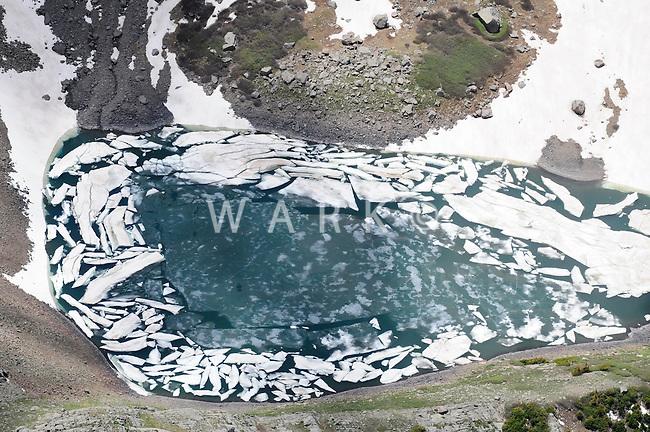 spring  melt of frozen mountain lake