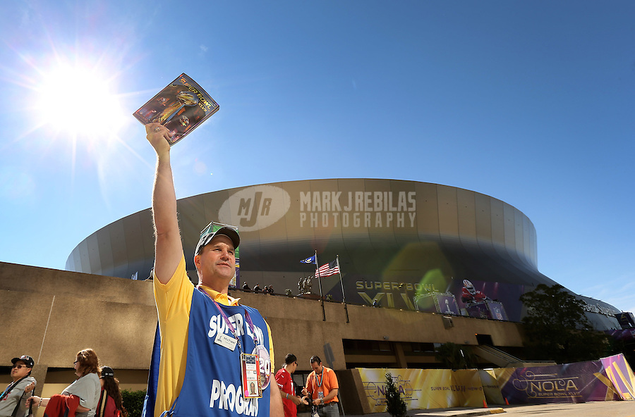 Feb 3, 2013; New Orleans, LA, USA; A vendor sells game programs outside the stadium prior to Super Bowl XLVII between the San Francisco 49ers and the Baltimore Ravens at the Mercedes-Benz Superdome. Mandatory Credit: Mark J. Rebilas-