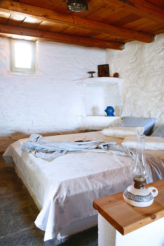 "Acclaimed architect Vartholomeos Martinos lovingly restored and reworked a 200-year-old stone barn on the ""off the beaten path"" island of Kithnos.  The result is a true to tradition yet comfortable space with charming details and respect for the environment."