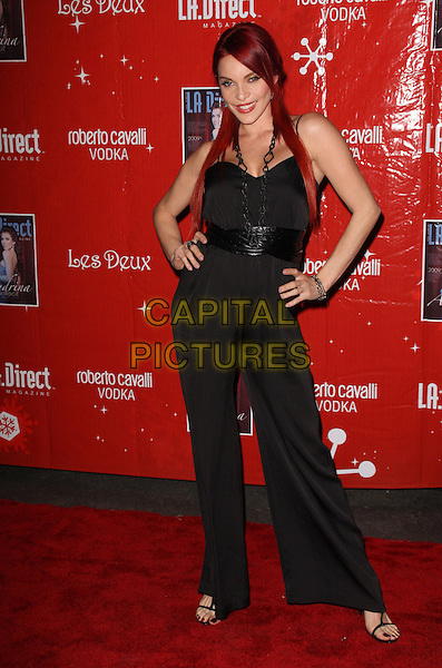 """CARMIT BACHAR.LA.Direct Magazine presents the 2nd Annual Remember to Give Holiday Party"""" Toy Drive, hosted by Audrina Patridge held at Les Deux, Hollywood, California, USA..December 11th, 2008.full length wide leg trousers top hands on hips belt catsuit .CAP/ADM/KB.©Kevan Brooks/AdMedia/Capital Pictures."""