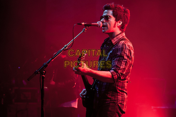 Kelly Jones of The Stereophonics play the Cambridge Corn Exchange, Cambridge, England..July 25th 2012.on stage in concert live gig performance performing music half length singing profile guitar checked shirt sunglasses shades .CAP/PP/MM.Mike Mustard/PP/Capital Pictures.