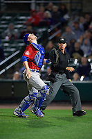 Buffalo Bisons catcher Danny Jansen (41) makes a play in front of umpire Chris Graham on a foul ball popup in the bottom of the eleventh inning during a game against the Rochester Red Wings on August 25, 2017 at Frontier Field in Rochester, New York.  Buffalo defeated Rochester 2-1 in eleven innings.  (Mike Janes/Four Seam Images)