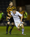 Raith's John Baird is pulled back by Alloa's Ben Gordon.