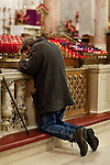 WATERBURY, CT-19 December 2012-121912BF01-- Brian Leyh from Waterbury prays the Rosary while kneeling in front of devotional candles inside the Basilica of the Immaculate Conception Wednesday night in Waterbury.  The mass was held to honor teachers in the aftermath of the Sandy Hook Elementary School shootings in Newtown last Friday. Bob Falcetti Republican-American
