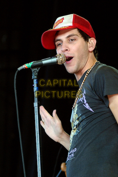 "GABE SAPORTA - COBRA STARSHIP .Performs as a part of the ""Honda Civic Tour 2007""  held at the Post-Gazette Pavilion, Pittsburgh, Pennsylvania, USA..May 22nd, 2007.half length stage concert live performance gig music red baseball cap hat microphone .CAP/ADM/JN.©Jason L. Nelson/AdMedia/Capital Pictures"