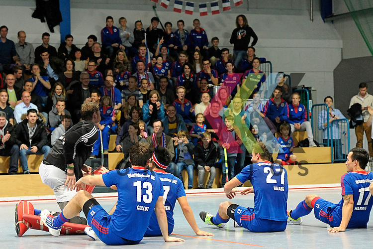 GER - Mannheim, Germany, December 12: Players of Mannheimer HC celebrate after winning the derby against TSV Mannheim on December 12, 2015 at Irma-Roechling-Halle in Mannheim, Germany. Final score 5-0 (HT 1-0). <br /> <br /> Foto &copy; PIX-Sportfotos *** Foto ist honorarpflichtig! *** Auf Anfrage in hoeherer Qualitaet/Aufloesung. Belegexemplar erbeten. Veroeffentlichung ausschliesslich fuer journalistisch-publizistische Zwecke. For editorial use only.