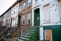 Dilapidated brownstones and homes for sale on Van Buren Street in the Bedford-Stuyvesant neighborhood of Brooklyn in New York on Sunday, November 20, 2011. (© Richard B. Levine)