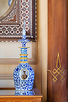 The opulent 19th century apartment  exudes sensuality, fantasy and passion. A Qajar opaline small carafe from the 19th century and an ottoman mirror from the 19th century are on display in the Oriental living space.