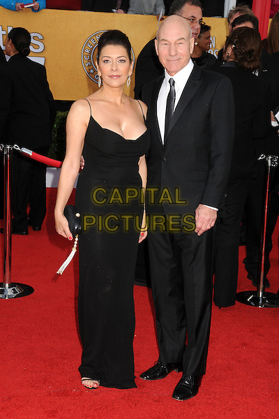 MARINA SIRTIS & PATRICK STEWART.17th Annual Screen Actors Guild Awards held at The Shrine Auditorium, Los Angeles, California, USA..January 30th, 2011.SAG arrivals full length dress suit  black hair up cleavage  .CAP/ADM/BP.©Byron Purvis/AdMedia/Capital Pictures.