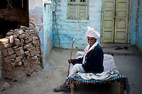 Jodha Ram Bishnoi sitting in front of his house at guda bishnoi village wearing taditional bishnoi dress. Jodhpur, Rajasthan, India. Arindam Mukherjee