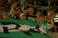 TUNJA - COLOMBIA -07 -03-2014: Hinchas, Atletico Nacional anima a su equipo durante partido aplazado de la octava fecha  de la Liga Postobon I-2014, jugado en el estadio La Independencia de la ciudad de Tunja. / Fans of Atletico Nacional encourage for their team during postponed match for the eighth date of the Liga Postobon I-2014 at the La Independencia  stadium in Tunja city, Photo: VizzorImage  / Jose M. Palencia / Str. (Best quality available)
