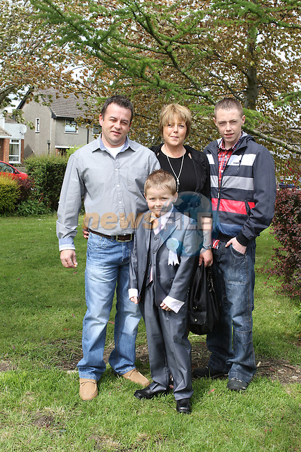 Jamie Healy with his family at the Communion in Ballsgrove Church...(Photo Jenny Matthews/www.newsfile.ie)
