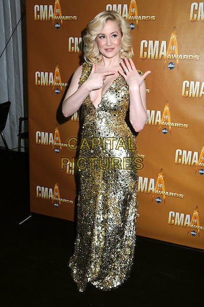 KELLIE PICKLER .44th Annual CMA Awards, Country Music's Biggest Night, held at Bridgestone Arena, Nashville, Tennessee, USA, 10th November 2010..CMAs country music full length gold sequined sequin long maxi sleeveless long maxi dress low cut cleavage hand finger pointing to ring engagement diamond .CAP/ADM/LF.©Laura Farr/AdMedia/Capital Pictures.