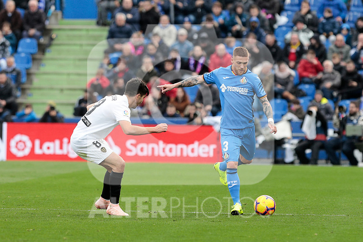 Getafe CF's Vitorino Antunes and Valencia CF's Carlos Soler during La Liga match between Getafe CF and Valencia CF at Coliseum Alfonso Perez in Getafe, Spain. November 10, 2018.