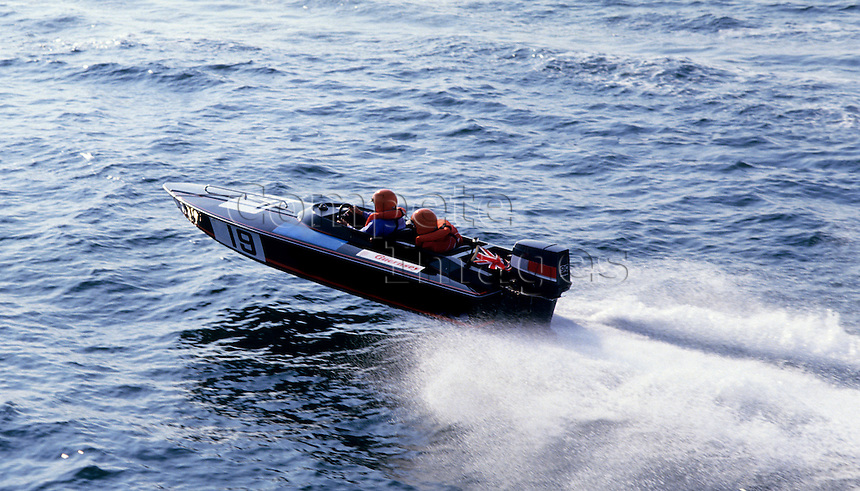 Multi Hull Powerboat drives through still water in race