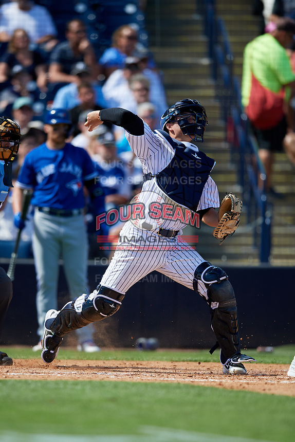 New York Yankees catcher Kyle Higashioka (66) throws to second base during a Grapefruit League Spring Training game against the Toronto Blue Jays on February 25, 2019 at George M. Steinbrenner Field in Tampa, Florida.  Yankees defeated the Blue Jays 3-0.  (Mike Janes/Four Seam Images)