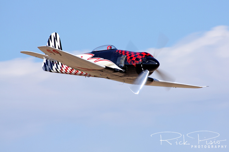 "Piloted by Shuttle Astronaut Robert ""Hoot"" Gibson the Hawker Sea Fury Race 99, ""Riff Raff,"" flies down the ""Valley of Speed"" during an Unlimited Class heat race at the 2009 Reno National Championship Air Races."