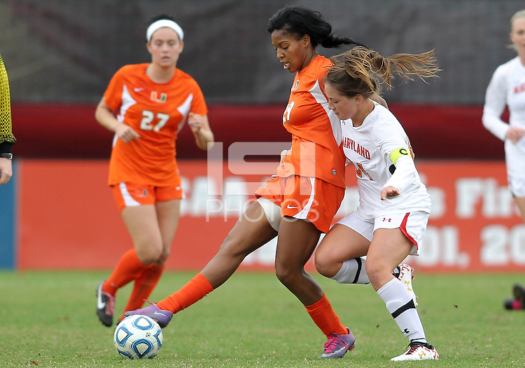 COLLEGE PARK, MD - OCTOBER 28, 2012:  Danielle Hubka (34) of the University of Maryland pushes into Blake Stockton (29) of Miami during an ACC  women's tournament 1st. round match at Ludwig Field in College Park, MD. on October 28. Maryland won 2-1 on a golden goal in extra time.