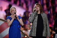 Washington, DC - May 24, 2014: Megan Hilty and American Idol winner Caleb Johnson perform the final number during a dress rehearsal for the National Memorial Day Concert May 24, 2014. (Photo by Don Baxter/Media Images International)