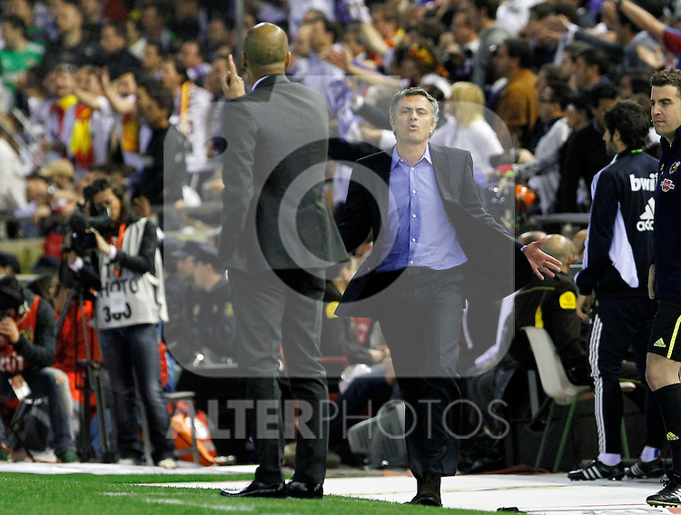 FC Barcelona's coach (l) coach Pep Guardiola (l) and Real Madrid's coach Jose Mourinho have words during King's Cup 2001 Final match.April 20,2011. (ALTERPHOTOS/Acero)