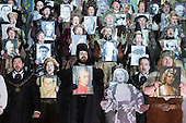 """London, UK. 30 January 2015. At the end of the opera, the 110-strong cast hold up pictures of famous German speakers as an homage to Wagner. Richard Wagner's opera """"The Mastersingers of Nuremberg"""" is performed live on stage during the dress rehearsal with English National Opera Music Director Edward Gardner leading the ENO Orchestra and Chorus. Directed by Richard Jones with with leads played by Gwyn Hughes Jones as Walter von Stolzing, Rachel Nicholls as Eva Pogner, Madeleine Shaw as Magdalene, Nicky Spence as David (Hans Sachs' apprentice), Iain Paterson as Hans Sachs, Andrew Shore as Sixtus Beckmesser and James Creswell as Veit Pogner. The opera will run for 8 performances at the London Coliseum from 7 February 2015. Photo: Bettina Strenske"""