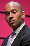 © Joel Goodman - 07973 332324 . 13/04/2015 . Manchester , UK . Chuka Umunna watches as Labour Party leader Ed Miliband launches the Labour Party manifesto ahead of the General Election at the Old Granada Studios in Manchester , UK . Photo credit : Joel Goodman