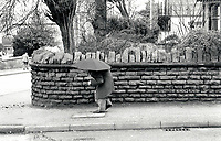 Elderly man with umbrella, Nottingham, UK 1991