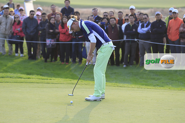 Marcel Siem (GER) takes his putt on the 16th green from the crowd during Sunday's Final Round of the 2014 BMW Masters held at Lake Malaren, Shanghai, China. 2nd November 2014.<br /> Picture: Eoin Clarke www.golffile.ie