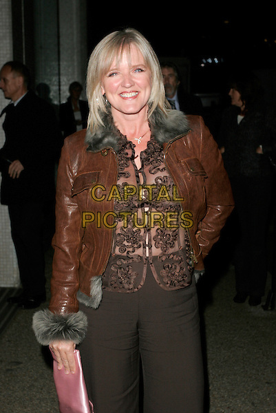 """COLEEN NOLAN.""""An Audience With Celine Dion"""" TV recording, LWT Studios, London, England. .October 30th 2007.half length brown leather jacket sheer top fur trim pink bag purse .CAP/AH.©Adam Houghton/Capital Pictures."""