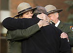 National ParK Service Rangers and Employees hug before the arrival of the hearse carrying the casket of National Park Service Ranger Margaret Anderson  during a memorial service at the Pacific Lutheran University in Tacoma on January 10, 2010. Anderson was slain at Mount Rainier on New Years' Day when she set up a road block to intercept a vehicle, driven by Benjamin Barnes, who failed to stop at a chain-up checkpoint.  Barnes, the suspect  in the shooting was found dead was found dead the next day. He had drown in Paradise Creek.   ©2012. Jim Bryant Photo. All RIGHTS RESERVED.