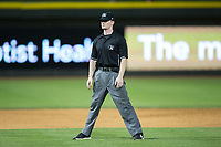 Umpire Thomas Roche handles the calls on the bases during the Carolina League game between the Buies Creek Astros and the Winston-Salem Dash at BB&T Ballpark on June 23, 2017 in Winston-Salem, North Carolina.  The Astros defeated the Dash 3-0.  (Brian Westerholt/Four Seam Images)