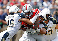 Ohio State Buckeyes running back Ezekiel Elliott (15) carries the ball against Navy Midshipmen linebacker Chris Johnson (46) and Jordan Drake (13) in the 1st quarter of their NCAA game at M&T Bank Stadium in Baltimore, Maryland on August 30, 2014. (Dispatch photo by Kyle Robertson)