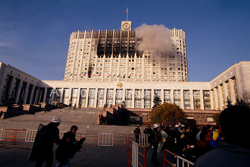 Moscow, Russia.October 4, 1993..Russian tanks fire directly into the face of the Parliament building in hopes of removing hundreds of well armed anti-Yeltsin demonstrators held up inside. Numerous tank rounds were fired into the face of the building during the day with the upper floors catching fire and burning throughout the night...Russian troops surround the building and take control of it after killing or arresting the armed demonstrators.
