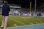 18 October 2014: Georgia Tech head coach Paul Johnson (left) watches as UNC drives for the game winning touchdown in the last minute of the game. The University of North Carolina Tar Heels hosted the Georgia Tech Yellow Jackets at Kenan Memorial Stadium in Chapel Hill, North Carolina in a 2014 NCAA Division I College Football game. UNC won the game 48-43.