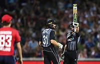 New Zealand batsman Colin Munro celebrates his 50 with Martin Guptill. New Zealand Black Caps v England.Tri-Series International Twenty20 cricket. Eden Park, Auckland, New Zealand. Sunday 18 February 2018. © Copyright Photo: Andrew Cornaga / www.Photosport.nz
