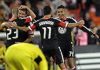 WASHINGTON, DC - OCTOBER 20, 2012:  Perry Kitchen (23), Nick DeLeon (18), Marcelo Saragosa (11) and Andy Najar (14) of D.C United celebrate victory against the Columbus Crew during an MLS match at RFK Stadium in Washington D.C. on October 20. D.C United won 3-2.