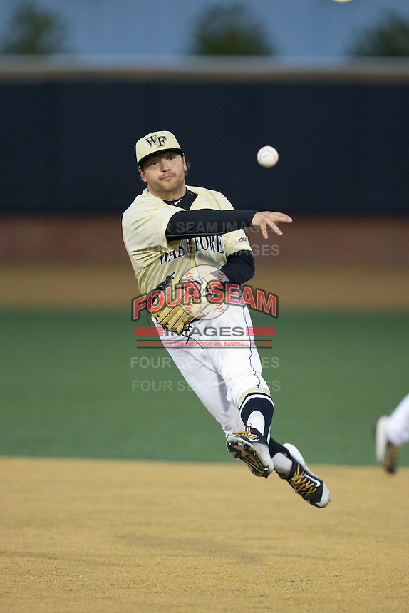 Wake Forest Demon Deacons second baseman Nate Mondou (10) makes a throw to first base against the UConn Huskies at Wake Forest Baseball Park on March 17, 2015 in Winston-Salem, North Carolina.  The Demon Deacons defeated the Huskies 6-2.  (Brian Westerholt/Four Seam Images)
