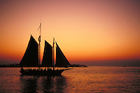 A tourist cruise ship (sailboat) in Key West, Florida watches the sunset. Key West Florida USA Ocean.