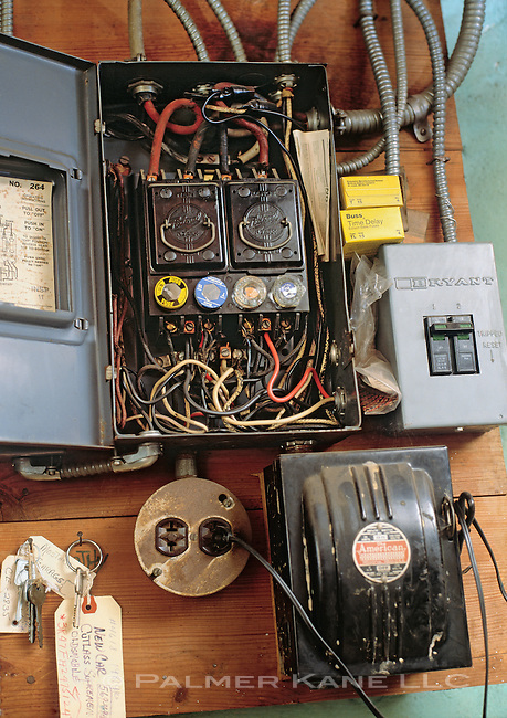 Old obsolete fuse box in the basement of a home