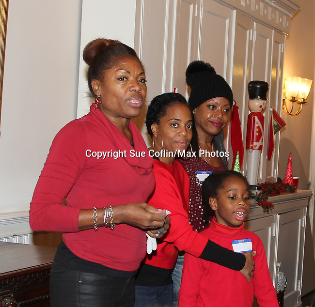 Founder HOG Deborah Koenigsberger, Actress and singer Rhonda Ross (Another World) and son Raif along with Designer Tracy Reese at Hearts of Gold links to a better life celebrates Christmas with a party #2 for mothers and their children on December 17, 2016 in New York City, New York with arts and crafts, a great turkey dinner with all the goodies and then the children met Santa Claus and had a photo with him as he gave them gifts. (Photo by Sue Coflin/Max Photos)