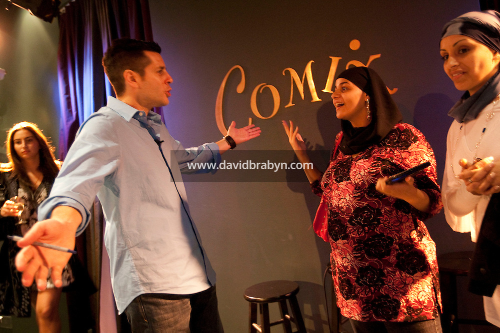 Comedian Dean Obeidallah (L) talks to audience members after performing in the 6th Annual NY Arab-American Comedy Festival in New York, USA, 13 May 2009.