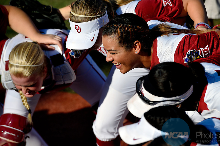 08 JUNE 2016:  Oklahoma infielder Paris Townsend (11) and the Oklahoma players huddle before the start of the Division I Women's Softball Championship is held at ASA Hall of Fame Stadium in Oklahoma City, OK.  KT King/NCAA Photos