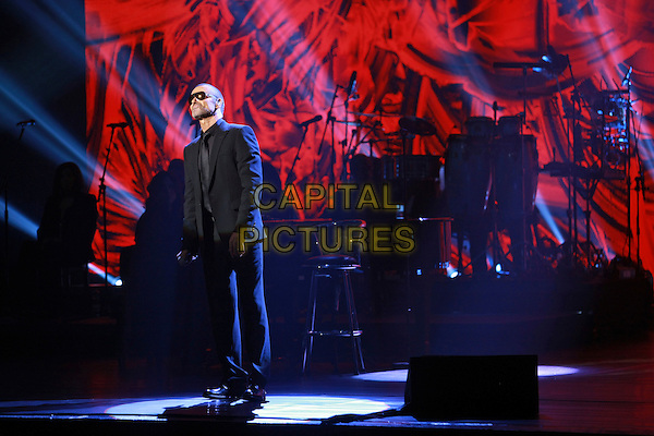 George Michael.premieres his European Orchestral Tour 'Symphonica' at the Prague State Opera House, Czech Republic  22nd August 2011..performing concert gig live on stage black suit sunglasses full length shades.*Editorial Use Only*.CAP/PLF.Supplied by Capital Pictures.