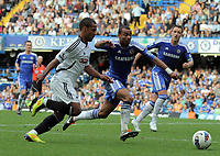 Pictured L-R: Wayne Routledge of Swansea against Ashley Cole of Chelsea. Saturday 17 September 2011<br /> Re: Premiership football Chelsea FC v Swansea City FC at the Stamford Bridge Stadium, London.