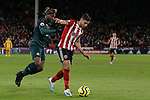 George Baldock (r) of Sheffield United runs past Allan Saint-Maximin of Newcastle United during the Premier League match at Bramall Lane, Sheffield. Picture date: 5th December 2019. Picture credit should read: James Wilson/Sportimage