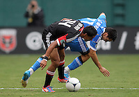 WASHINGTON, D.C. - AUGUST 19, 2012:  Andy Najar (14) of DC United srambles for the ball with Michael Farfan (21) of the Philadelphia Union during an MLS match at RFK Stadium, in Washington DC, on August 19. The game ended in a 1-1 tie.